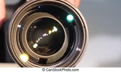 Camera zoom lens, glare, close up - Camera zoom lens, hand...