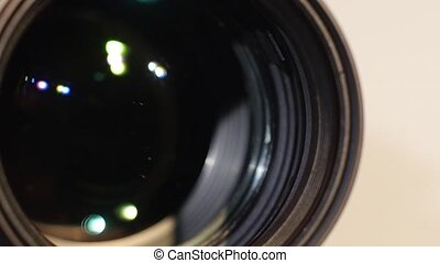 Part of camera zoom lens, glare, close up