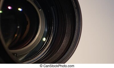 Part of camera zoom out lens, glare, close up