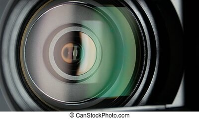 Video camera lens, showing zoom, close up - Black video...