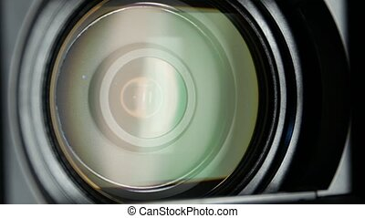 Video camera lens, showing zoom and glare, turns, close up -...