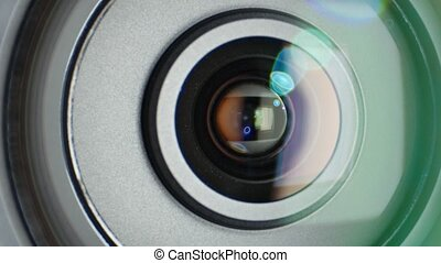 Glare on video camera lens, showing zoom, close up - Glares...