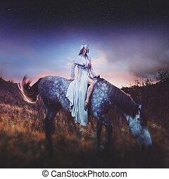 beauty blondie on horseback, amid the fabulous starry sky,...