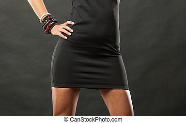 Female hips in black short dress