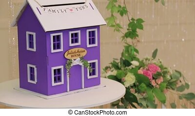 Model of the family house and bouquets with fresh flowers as decoration