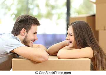Couple moving house looking each other - Profile of a happy...