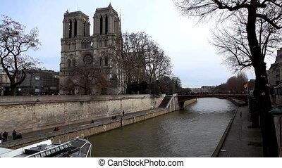 Notre Dame de Paris and pleasure boat on channel