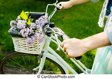 girl riding on a bicycle with flowers
