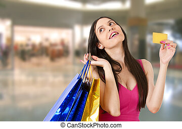 woman with shopping bags in mall