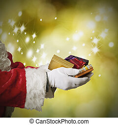 hands Santa Claus with Christmas gifts