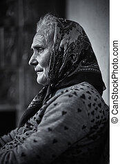 Senior woman indoor - Portrait of an old rural woman indoor...