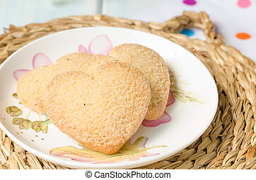 Heart-shaped butter cookies with sugar - Plate with three...
