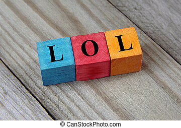 LOL text (Laughing Out Loud) on colorful wooden cubes