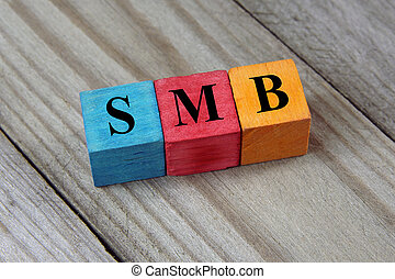 SMB text (Small Medium-sized Business) on colorful wooden...