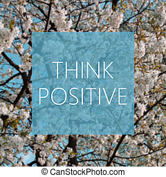 Think Positive concept, spring blooming tree in the...