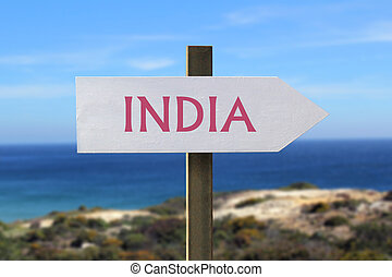 India sign with seashore in the background