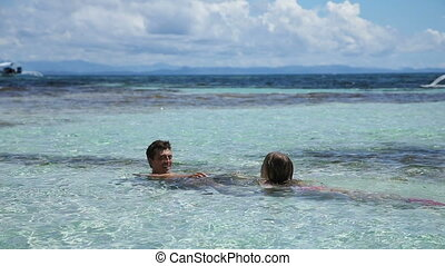 Father and daughter playing in the sea - Happy...