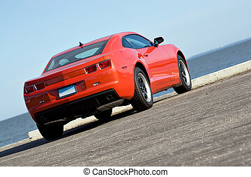 Modern Muscle Car - A modern muscle car parked at the sea...