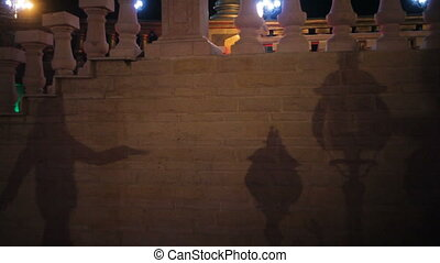 shadow of a woman on the wall