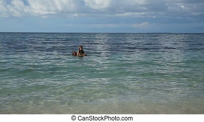 Father and his little daughter having fun on sea - Happy...
