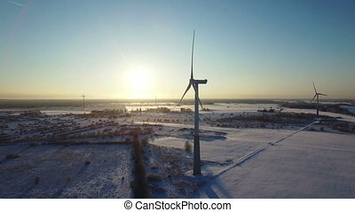 Wind turbines in frozen water, offshore park for energy.