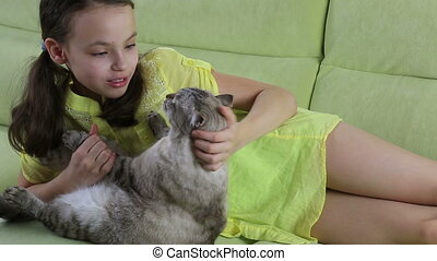 Little girl communicates with her beloved cat - Beautiful...