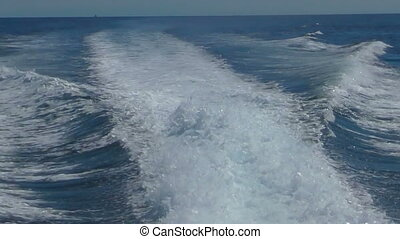 View from the rear of moving speedboat, slow motion