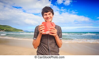 Guy Holds Shows Red Hearts Gift on Wave Surf Beach Smiles