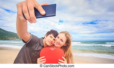 Guy Blond Girl Make Selfie with Heart Kiss on Beach Wave Surf