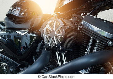 Motorcycle engine detail on street background