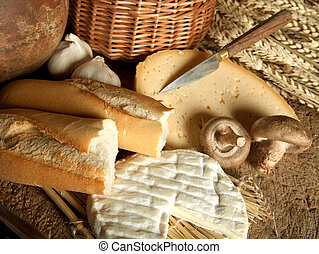 French picnic - Vintage meal of French cheese, baguette...