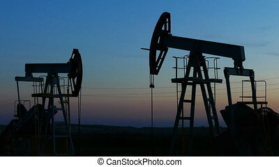 working oil pumps silhouette in dusk