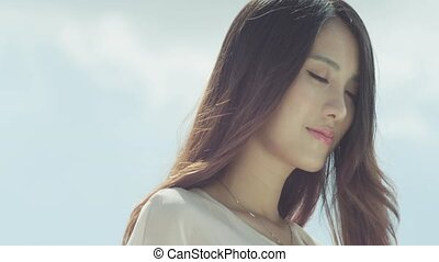 closeup of young woman enjoying