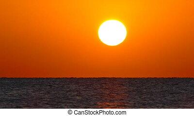 sea sunrise - shot with telephoto lens