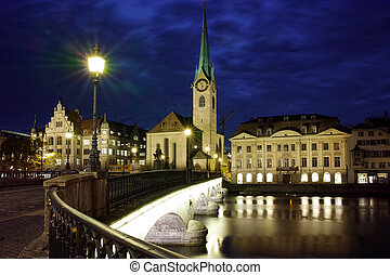 Night photo of Fraumunster Church and bridge over Limmat...