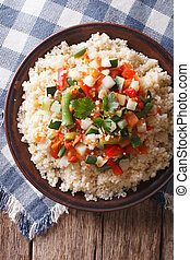Asian Couscous with vegetables close-up vertical top view -...