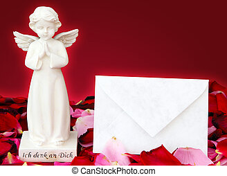 Angels and letter of consolation on rose petals