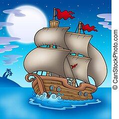 Old boat sailing sea at night