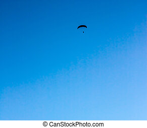 Paraglide on blue sky background - Paraglide silhouette...