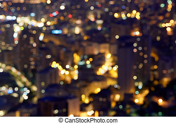 City buildings background at night, unfocused