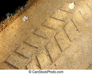 Excavator Tracks - Close up of the tracks left by an...