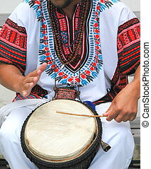 Conga drummer - Conga drummer performing outdoors in concert...