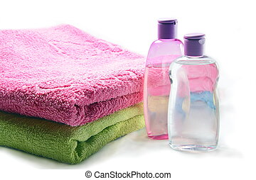 Bottles of Shampoo and Oil with Towels