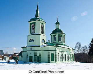 Orthodox church in the snow field