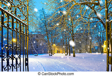 winter park with gateway in the snowfall by night, Town of...
