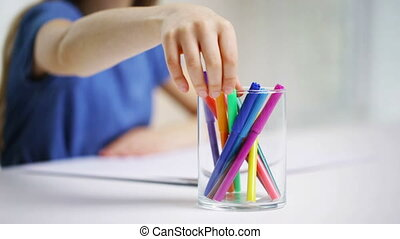felt-tip pens in glass and girl drawing - people, childhood,...