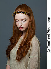 Attractive young redhead woman with hoop on her head -...