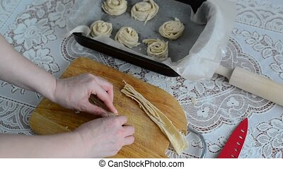 Housewife preparing bun of puff pastry - Housewife preparing...