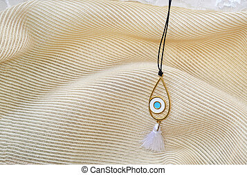 blue evil eye necklace - still life of a blue evil eye...