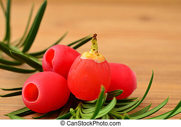 Yew berries close up - Red yew berries with green needles,...